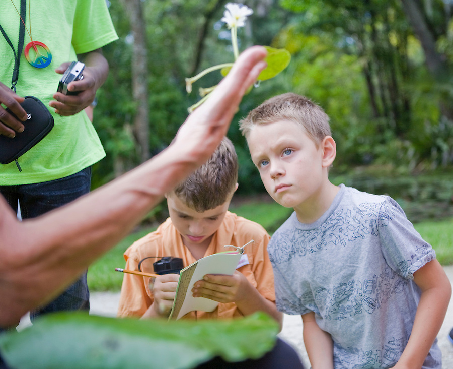 MAE GAMMINO/SPECIAL TO SCRIPPS TREASURE COAST NEWSPAPERS<br /> <br /> Tuesday at the McKee Botanical Gardens in Vero Beach during a horticulture session, children ages 5-9 have hands-on experiences with animals and plants native to Florida.