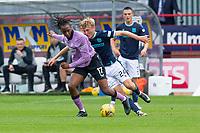 25th September 2021; Kilmac Stadium, Dundee, Scotland: Scottish Premiership football, Dundee versus Rangers; Max Anderson of Dundee is held off by Joe Aribo of Rangers