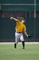 Pittsburgh Pirates Ryan Peurifoy (14) throws back to the infield during an Instructional League intrasquad black and gold game on October 13, 2017 at Pirate City in Bradenton, Florida.  (Mike Janes/Four Seam Images)