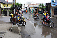 Indonesians riding small motorbikes in Jakarta.<br /> <br /> To license this image, please contact the National Geographic Creative Collection:<br /> <br /> Image ID:  1588010<br />  <br /> Email: natgeocreative@ngs.org<br /> <br /> Telephone: 202 857 7537 / Toll Free 800 434 2244<br /> <br /> National Geographic Creative<br /> 1145 17th St NW, Washington DC 20036