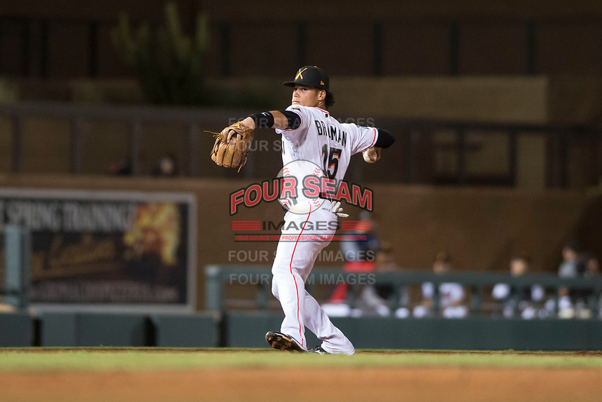 Salt River Rafters shortstop Bryson Brigman (15), of the Miami Marlins organization, throws to first base during an Arizona Fall League game against the Scottsdale Scorpions at Salt River Fields at Talking Stick on October 11, 2018 in Scottsdale, Arizona. Salt River defeated Scottsdale 7-6. (Zachary Lucy/Four Seam Images)