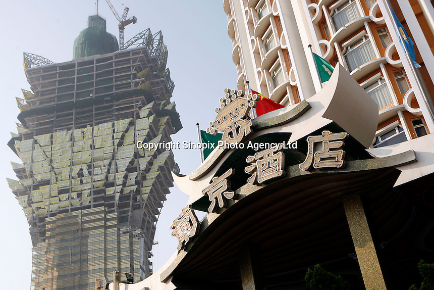 The Hotel Lisboa with the Grand Lisboa being built in the background. As restrictions on betting licences have become open to tender international Casino operators such as Wynn, Sands and MGM are making huge investments into Macau which is becoming the Vegas of the East and is driven by the massive Chinese gambling market on the former Portuguese colony's doorstep..