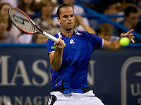 Xavier Malisse lines up a forehand during the Legg Mason Tennis Classic at the William H.G. FitzGerald Tennis Center in Washington, DC.  Unseeded Xavier Malisse defeated American John Isner in three sets in a thunderstorm delayed evening session.