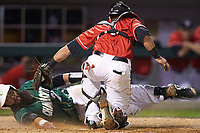 Derek Fritz (26) of the Charlotte 49ers is tagged out by catcher Skyler Weber (1) of the Georgia Bulldogs as he attempts to score on a squeeze play at BB&T Ballpark on March 8, 2016 in Charlotte, North Carolina. The 49ers defeated the Bulldogs 15-4. (Brian Westerholt/Four Seam Images)