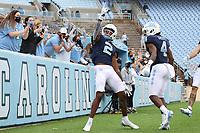 CHAPEL HILL, NC - OCTOBER 10: Dyami Brown #2 of North Carolina celebrates his touchdown with teammate Toe Groves #4 during a game between Virginia Tech and North Carolina at Kenan Memorial Stadium on October 10, 2020 in Chapel Hill, North Carolina.