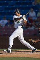 Salvador Sanchez (41) of the Winston-Salem Warthogs follows through on his swing versus the Salem Avalanche at Ernie Shore Field in Winston-Salem, NC, Saturday, May 10, 2008.