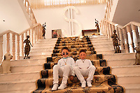 Six year old twins Gelu and Edi Petrache sit on stairs in a mansion on Easter Sunday. Buzescu is known for it's ultra-wealthy Roma and their bizarre mansions that line the main street. The Roma of Buzescu are part of the Kalderash clan and are known for being coppersmiths and dealing with metal scraps. After the fall of the communist regime in the late 80's, they stripped old factories of their metals and some made a small fortune re-selling them. They are also known for making cazane, copper stills that produce alcohol such as palinka, a plum brandy.