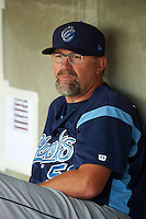 Corpus Christi Hooks pitching coach Doug Brocail (50) in the dugout before a game against the Arkansas Travelers on May 29, 2015 at Dickey-Stephens Park in Little Rock, Arkansas.  Corpus Christi defeated Arkansas 4-0 in a rain shortened game.  (Mike Janes/Four Seam Images)
