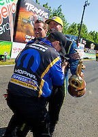 Jun 7, 2015; Englishtown, NJ, USA; NHRA funny car driver Matt Hagan celebrates with crew members after winning the Summernationals at Old Bridge Township Raceway Park. Mandatory Credit: Mark J. Rebilas-