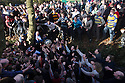 """17/02/15  <br /> <br /> Play moves into the river at the annual Royal Shrovetide Football  Match in Ashbourne, Derbyshire. After 'turning up' the ball at 2pm thousands of rival Up'Ards' and Down'Ards' team members attempt to 'goal' the ball onto stones set three miles apart in the town of Ashbourne, Derbyshire. The game also known as """"hugball"""" has been played from at least c.1667 although the exact origins of the game are unknown but one of the most popular origin theories suggests the macabre notion that the 'ball' was originally a severed head tossed into the waiting crowd following an execution.<br /> <br /> <br /> All Rights Reserved - F Stop Press.  www.fstoppress.com. Tel: +44 (0)1335 418629 +44(0)7765 242650"""