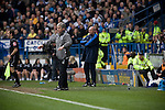 Sheffield Wednesday 2 Crystal Palace 2, 02/05/2010. Hillsborough. Championship. Crystal Palace manager Paul Hart (in background behind home manager Alan Irvine) watching his team at Hillsborough during the first half of the crucial last-day relegation match against Sheffield Wednesday. The match ended in a 2-2 draw which meant Wednesday were relegated to League 1. Crystal Palace remained in the Championship despite having been deducted 10 points for entering administration during the season. Photo by Colin McPherson.