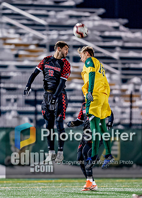 13 November 2019: University of Hartford Hawk Midfielder Tomer Drimmer, a Sophomore from Shoham, Israel, heads the ball away from University of Vermont Catamount Midfielder Daði Bærings Halldórsson, a Junior from Reykjavik, Iceland, at Virtue Field in Burlington, Vermont. The Hawks defeated the Catamounts 3-2 in sudden death overtime of the Division 1 Men's Soccer America East matchup. Mandatory Credit: Ed Wolfstein Photo *** RAW (NEF) Image File Available ***
