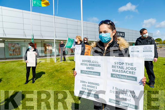 Amanda Howard holds a sign as Debenhams workers protest outside the shop on Wednesday.