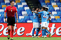 Hirving Lozano of SSC Napoli celebrates with team mates  after scoring the goal of 1-0 during the Serie A football match between SSC Napoli and Genoa CFC at San Paolo stadium in Napoli (Italy), September 27th, 2020. Photo Cesare Purini / Insidefoto