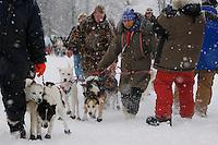 Handlers, including Barb Redington help Garry McKeller's team to the start line of the 2009 Junior Iditarod on Knik Lake on Saturday Februrary 28, 2009.