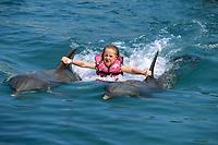 girl towed by, atlantic bottlenose dolphin, Tursiops truncatus, Puerto Plata, Dominican Republic, Caribbean, Atlantic (c)