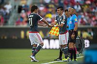 Orlando, Florida - Saturday, June 04, 2016: Paraguayan forward Oscar Romero (21) is substituted for Paraguayan midfielder Edgar Benitez (11) during a Group A Copa America Centenario match between Costa Rica and Paraguay at Camping World Stadium.