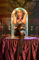 BNPS.co.uk (01202 558833)<br /> Pic: MaxWillcock/BNPS<br /> <br /> Pictured: Lucy Fear in a bottle.<br /> <br /> The Circus of Horrors cast prepare for their evening performance at the Tivoli Theatre in Wimborne Minster, Dorset as part their tour of UK. The Circus of Horrors is a British-based contemporary circus, they were first seen performing at the Glastonbury Festival in 1995.