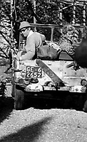 BNPS.co.uk (01202) 558833.<br /> Pic: H&HAuctions/BNPS<br /> <br /> Pictured: Rex Harrison reversing the Jeep<br /> <br /> A World War Two jeep owned by Doctor Doolittle star Rex Harrison is expected to sell for £30,000.<br /> <br /> The durable 1943 Ford GPW originally served with the British army's 6th armoured division and was later bought by the Oscar winner in Italy.  <br /> <br /> Two original pictures of Harrison in the military green vehicle, including one with glamorous Hollywood icon, Rita Hayworth, are included in the sale.
