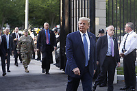 United States President Donald J. Trump returns after posing with a bible outside St. John's Episcopal Church after delivering remarks in the Rose Garden at the White House in Washington, DC, USA, 01 June 2020. Trump addressed the nationwide protests following the death of George Floyd in police custody.<br /> Credit: Shawn Thew / Pool via CNP/AdMedia