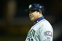 Gwinnett Braves coach Einar Diaz (28) coaches first base during the game against the Durham Bulls at Durham Bulls Athletic Park on April 20, 2019 in Durham, North Carolina. The Bulls defeated the Braves 3-2 in game two of a double-header. (Brian Westerholt/Four Seam Images)