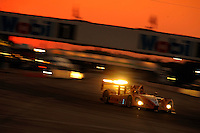 12-15 March 2008, Sebring, Florida, USA.The #7 DHL Porsche speeds through turn 1 during night practice..©F.Peirce Williams 2008, USA .