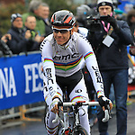 World Champion Philippe Gilbert (BEL) BMC Racing Team makes his way to the sign on before the start of the 104th edition of the Milan-San Remo cycle race at Castello Sforzesco in Milan, 17th March 2013 (Photo by Eoin Clarke 2013)