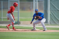 GCL Mets first baseman Luis Montero (69) catches a pick off attempt throw as Delvin Perez (15) gets back to the bag during a game against the GCL Cardinals on July 23, 2017 at Roger Dean Stadium Complex in Jupiter, Florida.  GCL Cardinals defeated the GCL Mets 5-3.  (Mike Janes/Four Seam Images)