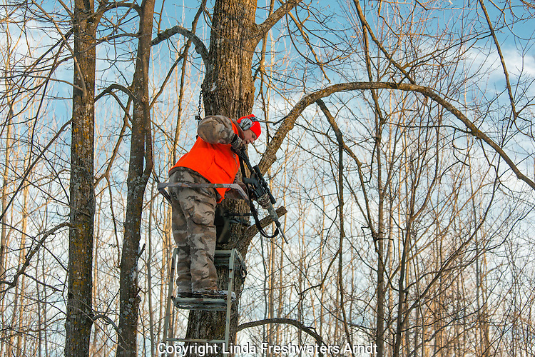 Wisconsin hunter pulling his AR-15 up with a rope