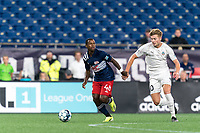 FOXBOROUGH, MA - SEPTEMBER 1: Michel #48 of New England Revolution II looks to pass as Charlie Dennis #10 of FC Tucson closes during a game between FC Tucson and New England Revolution II at Gillette Stadium on September 1, 2021 in Foxborough, Massachusetts.