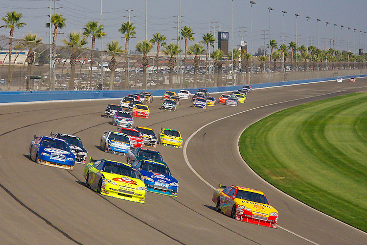 Oct. 11, 2009. Auto Club Speedway, CA: Kevin Harvick and Mark Martin lead the field through the turn.
