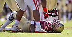 One of the Clemson players reaches down to help up injured Florida State quarterback Deondre Francois in the first half of an NCAA college football game in Tallahassee, Fla., Saturday, Oct.27, 2018. Clemson defeated Florida State 59-10. (AP Photo/Mark Wallheiser)