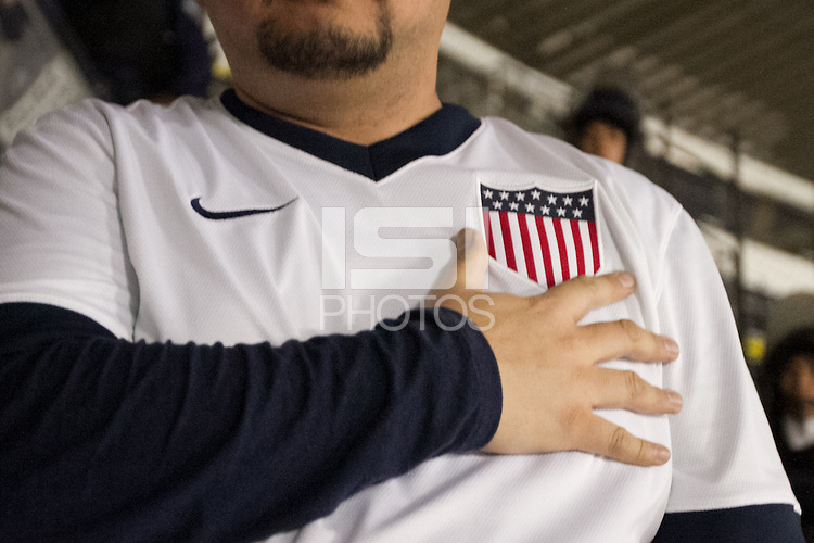 A USA fan places his hand near the USA centennial crest at Azteca stadium before the USA vs. Mexico World Cup Qualifier in Mexico City, Mexico on March 26, 2013.