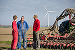 Ralph De Clerck, (m) and Stephan de Clerck (r) speak with Ralph's son, Maarten (l) during an afternoon on the farm in Swifterbant, the Netherlands...The de Clerck family has been farming wind energy for over a decade. Together the two brothers, Stephan and Ralph are producing over 7.5MW of wind energy and selling it to the grid. The wind energy is an important crop that allows them to diversify their product. They continue to farm their land, planting potatoes and the wind mills run in the background.