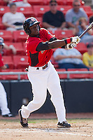 Guillermo Pimentel #3 of the Hickory Crawdads swings and misses against the Greensboro Grasshoppers at  L.P. Frans Stadium July 10, 2010, in Hickory, North Carolina.  Photo by Brian Westerholt / Four Seam Images