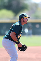 Renato Nunez #17 of the Oakland Athletics during a Minor League Spring Training Game against the Los Angeles Angels at the Los Angeles Angels Spring Training Complex on March 17, 2014 in Tempe, Arizona. (Larry Goren/Four Seam Images)