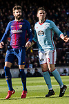 Gerard Pique Bernabeu of FC Barcelona (L) fights for position with Andreu Fontas Prat of RC Celta de Vigo (R) during the La Liga 2017-18 match between FC Barcelona and RC Celta de Vigo at Camp Nou Stadium on 02 December 2017 in Barcelona, Spain. Photo by Vicens Gimenez / Power Sport Images