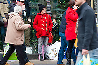 Saturday 14 December 2013<br /> Pictured:A lady Stands with her many bags amongst the  Crowds of Shoppers along Swansea's busy Oxford Street in the City Centrre<br /> Re: Towns and City's are busy with shoppers  across the UK as Christmas  is only 10 days away.
