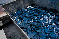 Cracked rocks of indigo paste, dried on the sun, are seen in the metal box at the semi-industrial manufacture near San Miguel, El Salvador, 12 November 2016. For centuries, indigo, a natural deep blue dye extracted from the leaves of tropical plants (Indigofera), has been known to the native indigenous inhabitants of Central America who used the blue tincture to color their fabrics and pottery. Although demand for natural indigo dropped significantly at the end of 19th century when a synthetic indigo was firstly introduced, commercialization of natural indigo has risen again during the last decades. Small-scale indigo farms, processing the crop on sustainable and ecological basis, are growing throughout the country, returning El Salvador to the place of the main natural indigo producer in Latin America.
