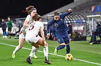 French Amel Majri (10) pictured in a duel with Swiss Svenja Folmli (17) and Swiss Lara Marti (5) during the Womens International Friendly game between France and Switzerland at Stade Saint-Symphorien in Longeville-lès-Metz, France.