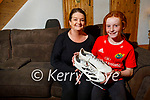11-year-old Hanna O'Connell from Abbeydorney with her mom Marisa Reidy who received Munster Rugby player Simon Zebo's matchday boots at Thomond Park last Saturday.