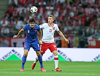 8th September 2021; PGE National Stadium, Warsaw, Poland: FIFA World Cup 2022 Football qualification, Poland versus England;  HARRY MAGUIRE clears with a header from ADAM BUKSA