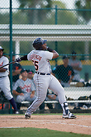 Detroit Tigers Luis Laurencio (55) follows through on a swing during a Florida Instructional League game against the Pittsburgh Pirates on October 2, 2018 at the Pirate City in Bradenton, Florida.  (Mike Janes/Four Seam Images)