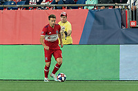FOXBOROUGH, MA - AUGUST 24: Przemyslaw Frankowski #11 of Chicago Fire dribbles at midfield during a game between Chicago Fire and New England Revolution at Gillette Stadium on August 24, 2019 in Foxborough, Massachusetts.