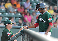 Left fielder Keury De la Cruz (25) of the Greenville Drive is congratulated after scoring a run in a game against the Rome Braves on May 6, 2012, at Fluor Field at the West End in Greenville, South Carolina. Greenville won, 11-3. (Tom Priddy/Four Seam Images)