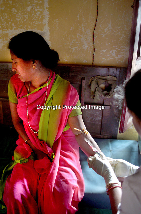 INDIA (West Bengal - Calcutta) - Blood is being collected for testing.  These blood testing camps are conducted by  NGOs to detect HIV and STDs among sex workers, Arindam Mukherjee