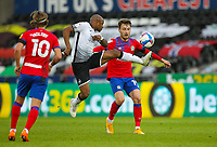 31st October 2020; Liberty Stadium, Swansea, Glamorgan, Wales; English Football League Championship Football, Swansea City versus Blackburn Rovers; Andre Ayew of Swansea City and Tom Trybull of Blackburn Rovers challenge for the ball
