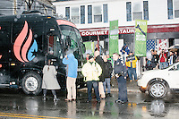 People stand outside the candidate's campaign bus before Texas senator and Republican presidential candidate Ted Cruz speaks at The Village Trestle restaurant in Goffstown, New Hampshire, on Wed., Feb. 3, 2016.