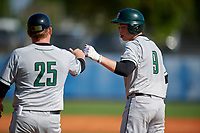 Dartmouth Big Green catcher Ben Rice (9) fist bumps coach David Vandercook (25) during a game against the Bradley Braves on March 21, 2019 at Chain of Lakes Stadium in Winter Haven, Florida.  Bradley defeated Dartmouth 6-3.  (Mike Janes/Four Seam Images)