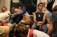 World Cup soccer fans who attended the USA's 1-1 draw with Italy in Kaiserslautern sleep or rest, on an early morning local train to Mannheim, Germany near Kaiserslautern Germany  on Saturday June 18th, 2006.